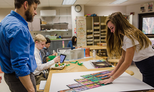 Student and teacher collaborating in Middle School art studio